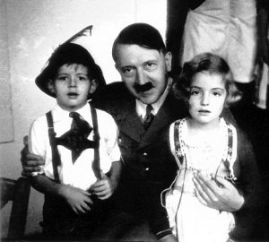 Hitler, hugging a couple of kids.