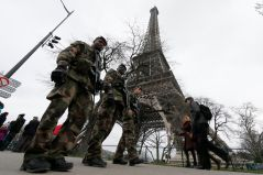 French soldiers patrol near the Eiffel Tower in Paris